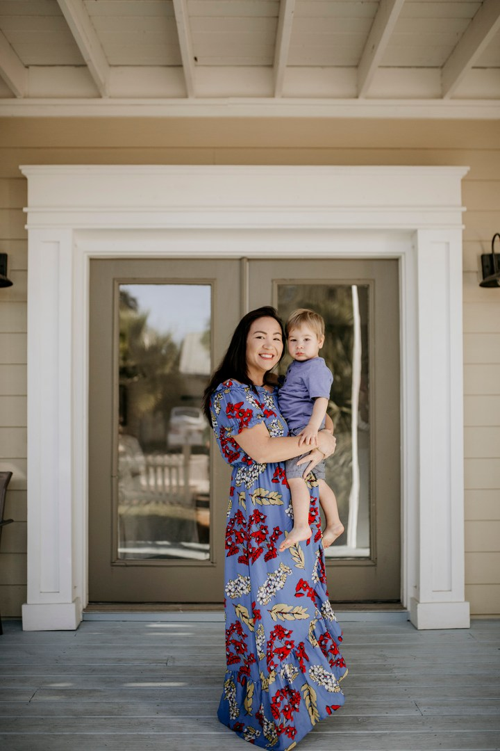 Summer Dresses - Mom in blue floral maxi dress off the shoulders and boy toddler in blue t-shirt and shorts