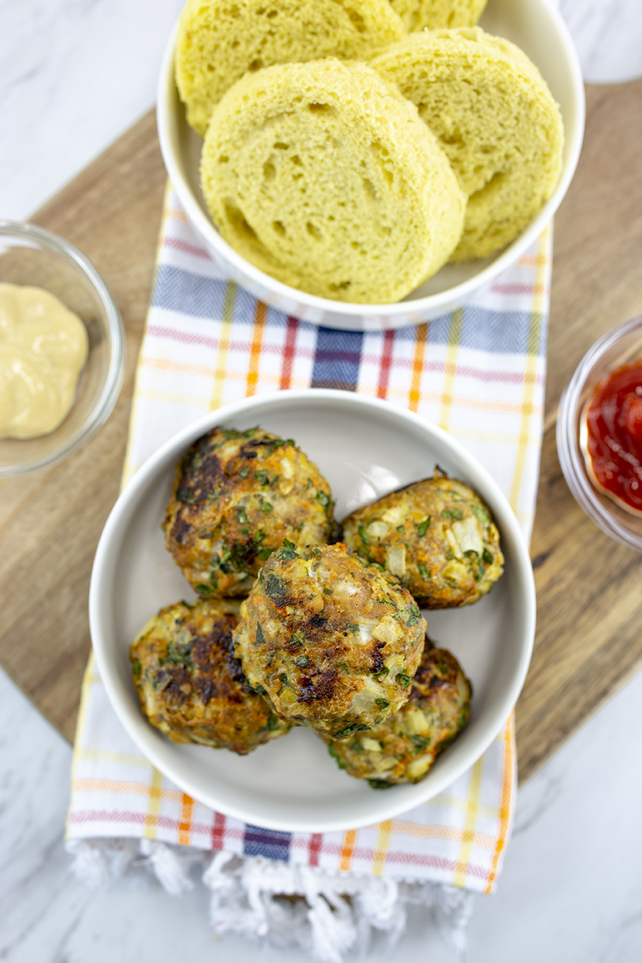 Low carb turkey meatballs served with keto bread, mustard and ketchup