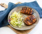 Grilled Korean Pork Chops served with apple cider vinegar slaw