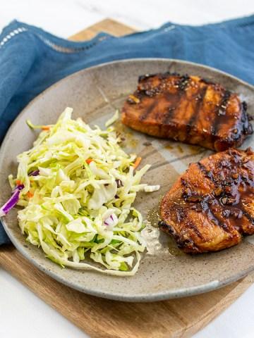 Grilled Korean Pork Chops served with apple cider vinegar slaw