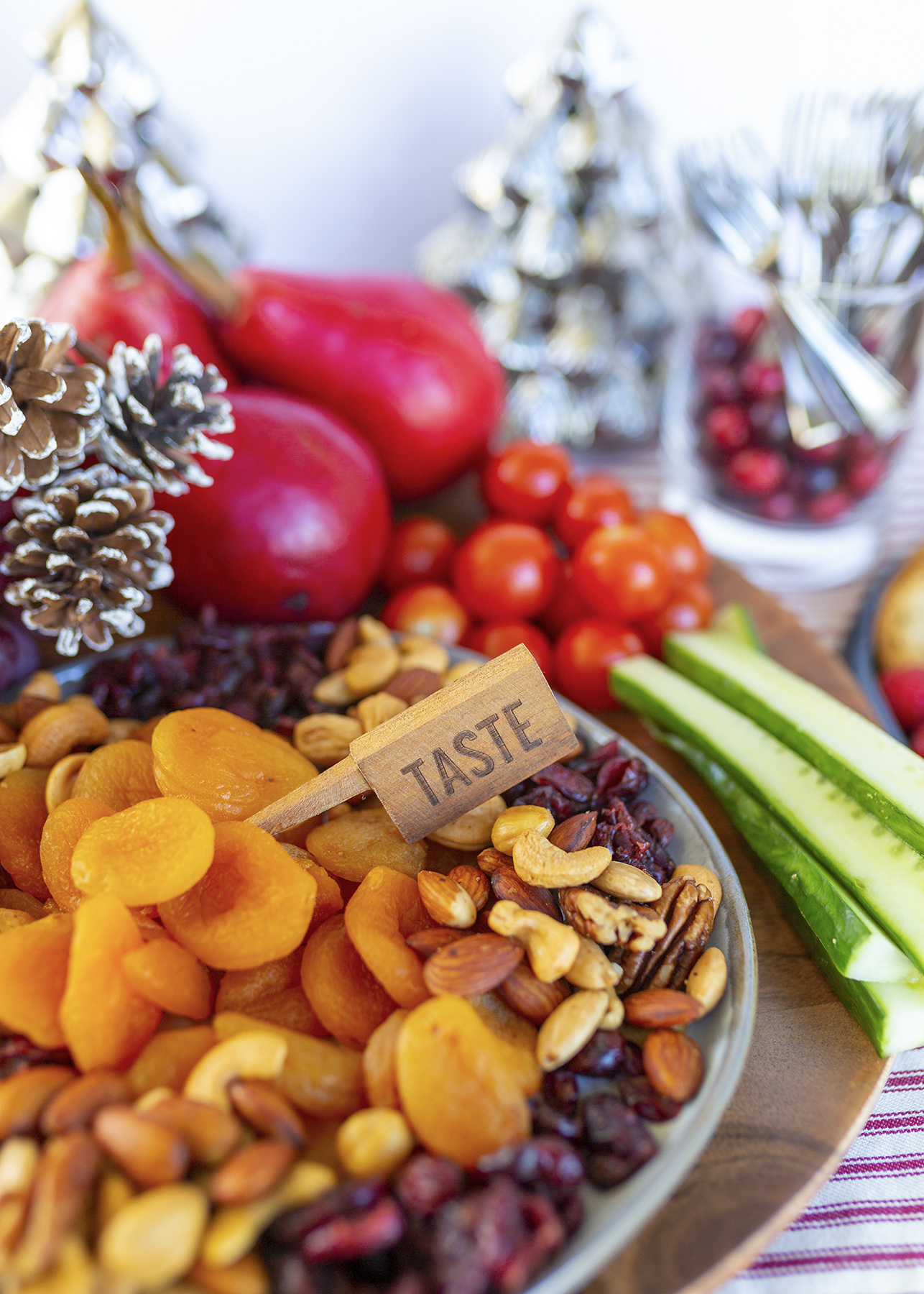 Nuts, dried fruits and vegetables set up in snacking station/ grazing table