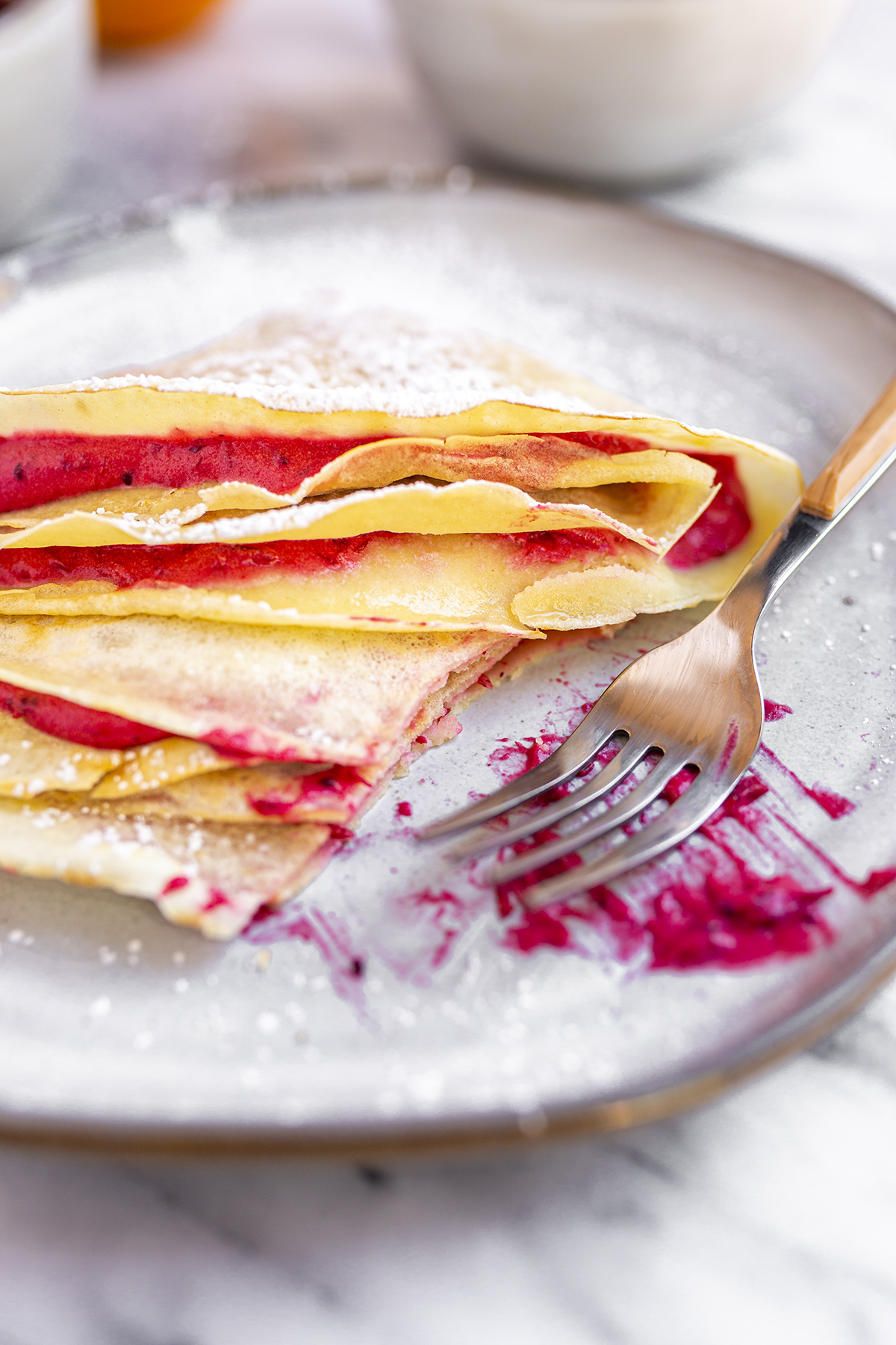 Delicious French Crepes filled with Cranberry, Orange and Mascarpone. Great for Breakfast, brunch or dessert.