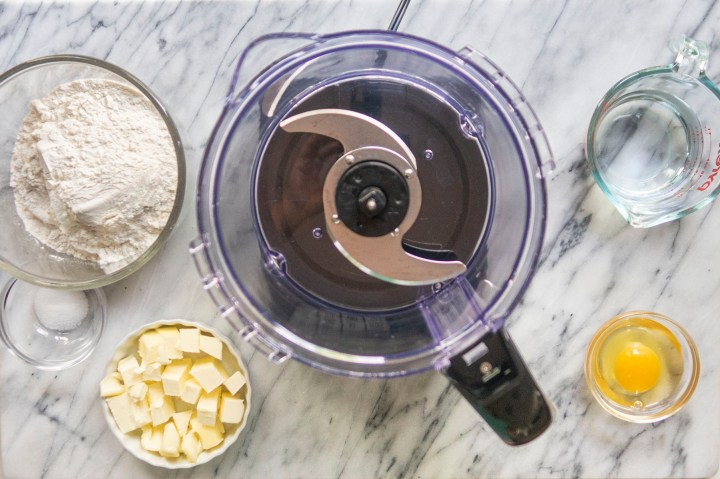 Ingredients for homemade empanada dough for baking recipe - egg, butter, water, salt and flour