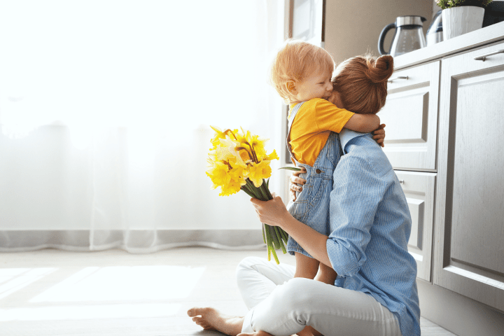 Mothers Day Coloring Pages - boy and mom hug while sitting on the floor