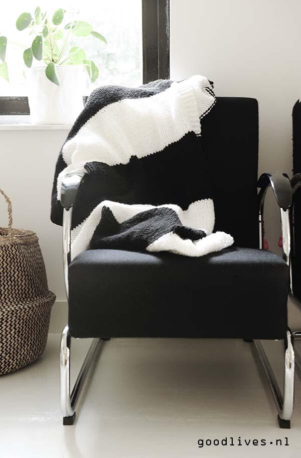 Zwart witte plaid over stoel
