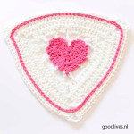 Crocheting a flag with a heart in it for the World record