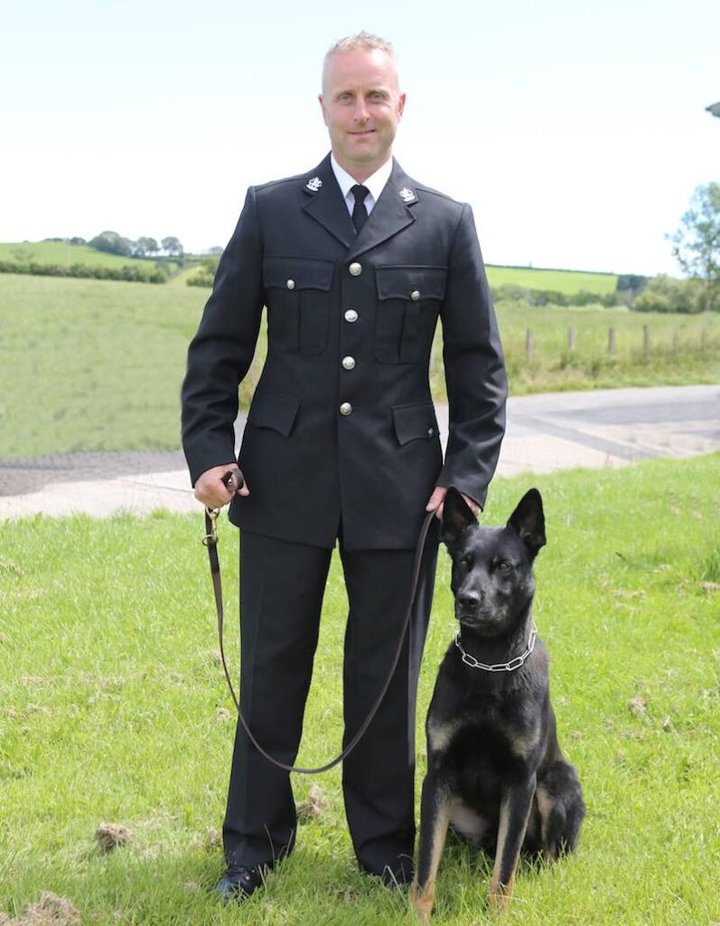 Officer Peter Lloyd and police dog Max, Photo by Dyfed-Powys Police