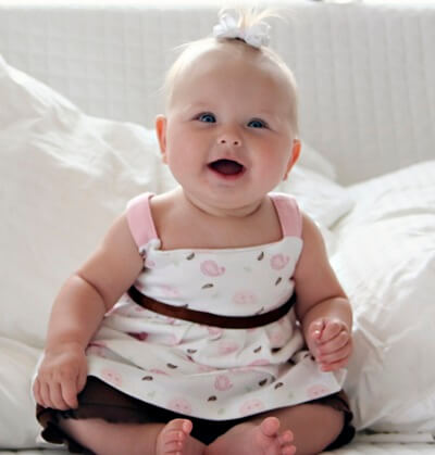 photo of cute baby girl with a smile