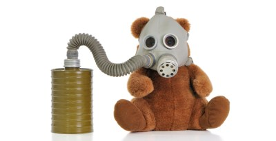 Teddy bear wearing gas mask