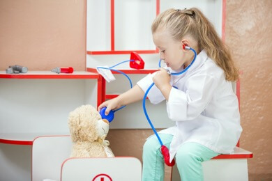 young girl playing vet