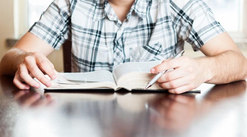Hispanic Teenager Reading The Bible