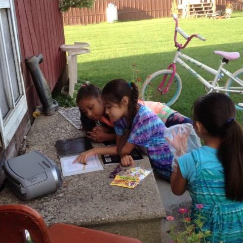 Girls reading The Lamb