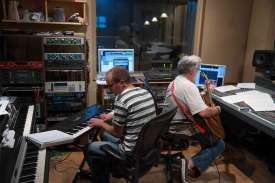Allan and Roy work to get the guitar track recorded.