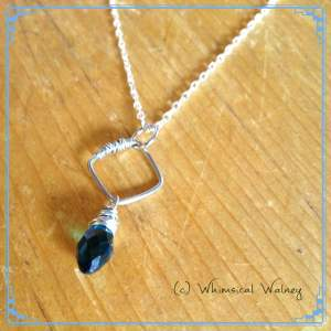Dainty necklace with wire wrapped blue crystal