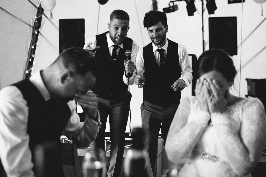 Groomsmen embarrass the bride and groom