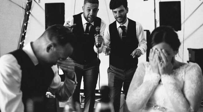 Groomsmen embarrass the bride and groom