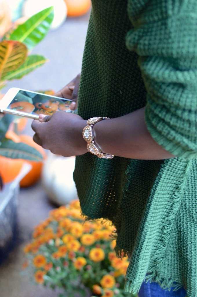 Picking pumpkins in the perfect sweater for fall