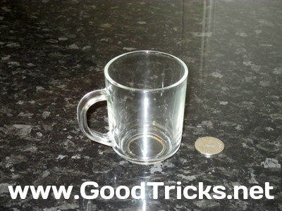 Item needed to perform this illusion, a small galss and a coin.