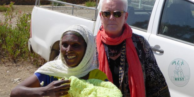 usaid-administrator-gayle-smith-is-welcomed-with-the-traditional-ethiopian-greeting-of-popcorn-rest-the-logo-on-the-truck-is-the-psnp-implementer-in-tigray