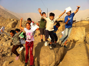 kids jumping off a rock