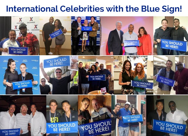 International Celebrities with the You Should Be Here Blue Sign!