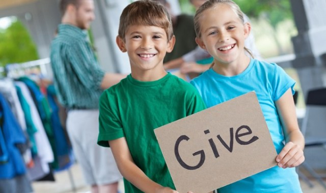 """Kids holding a """"Give"""""""" sign"""