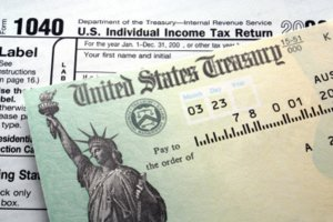 US Treasury note on top of IRS forms