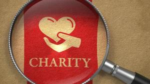 Magnifying glass over charity