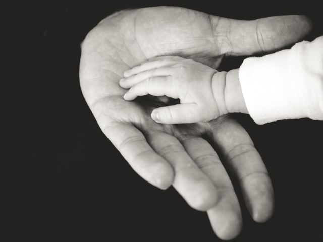 old hand and baby hand
