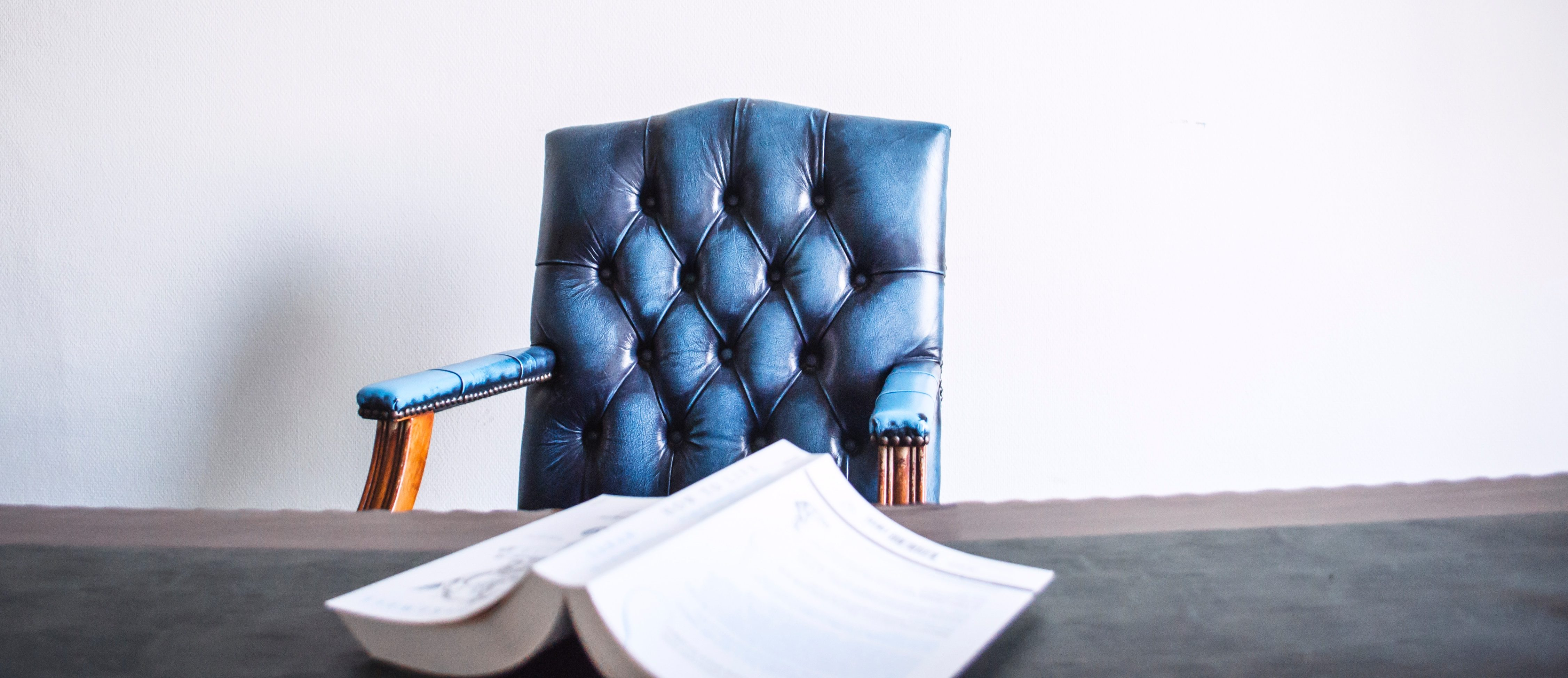 Conflict of Interest chair with book on table