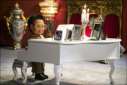 Kim playing piano in Team America