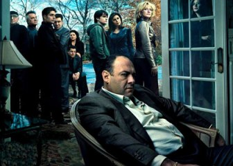 Note how the mobsters are in gathered in one group, Tony's family in the other, and Tony id seated, brooding, apart from both groups.