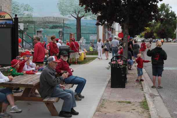 Crowd of people on Gore Bay's main street enjoying Canada Day
