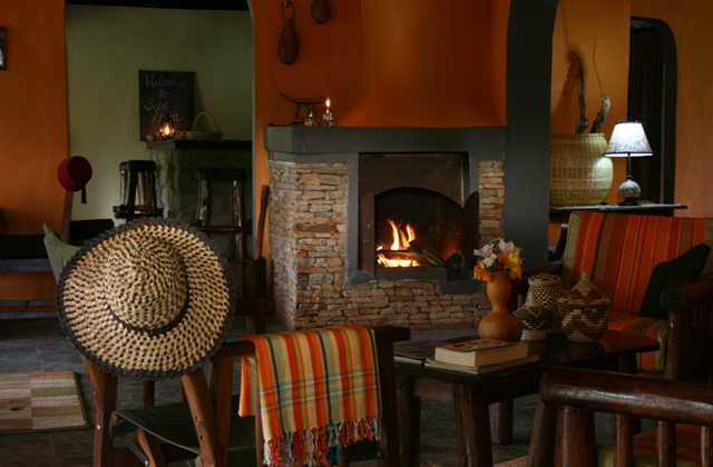 Sipi River Lodge, lounge and fireplace