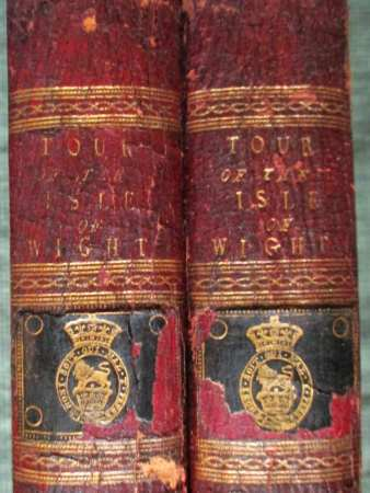 """The backs of both volumes are decorated with the Garter motto: """"Honi soit qui mal y pense"""" enclosing the rampant Lion of England  and a coronet, surmounted by a  second coronet. These books were likely bound for William Henry, Prince of Brunswick-Luneburg (1765-1837), Duke of Clarence and St. Andrew, to whom John Hassell dedicated this two volume title."""