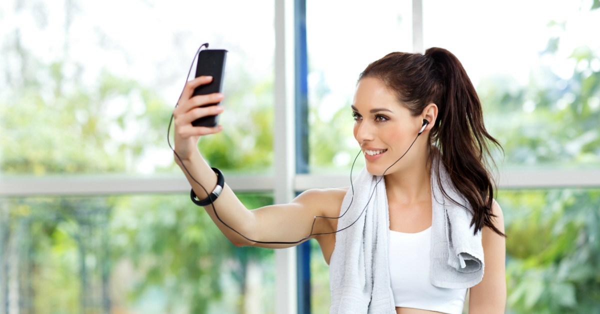 Image result for people using their phone at the gym