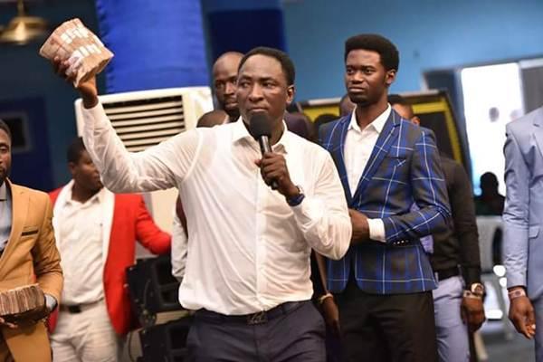 Prophet Jeremiah Showers Money On Fellow Pastor