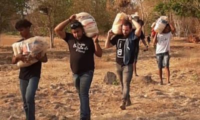 Voluntários da Batista Poconé entregam alimentos