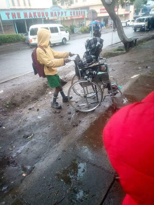 wheel4 - Heartwarming Photos And Story Of 10-year-old Boy Who Wheels His Paralysed Mother To Her Shop Everyday Before Going To School