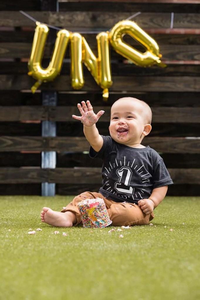 Baby-smiling-and-waving.jpg