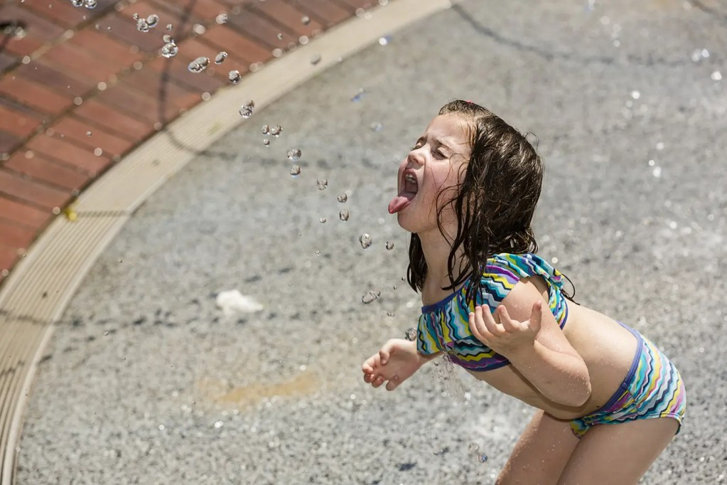 photograph-of-girl-catching-water-beads-in-Central-Park.jpg