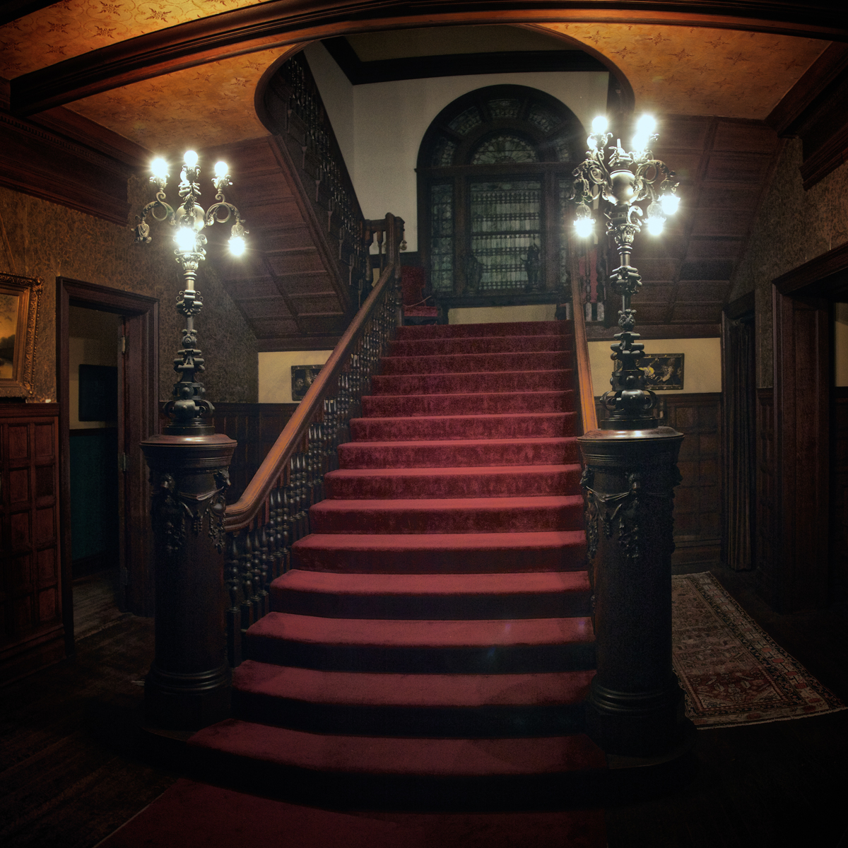 The main staircase at night, where Mark Twain spoke at Rockcliffe Mansion