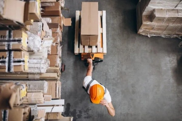 warehouse picker moving inventory for delivery