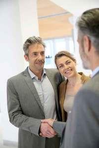 bigstock-Adviser-giving-handshake-to-cl-86878130-LR