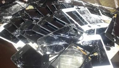 pile of broken iPhone screens