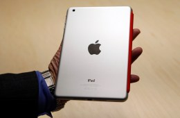 A visitor looks over the new iPad mini at an Apple event in San Jose