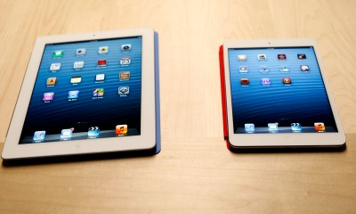 The new iPad mini is shown next to a full sized model at an Apple event in San Jose