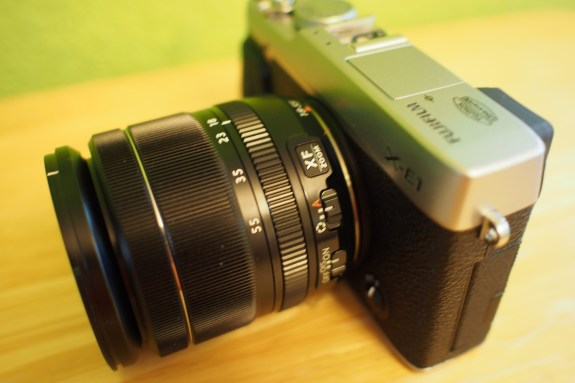 Toggles for manual aperture and OIS located on lens barrel
