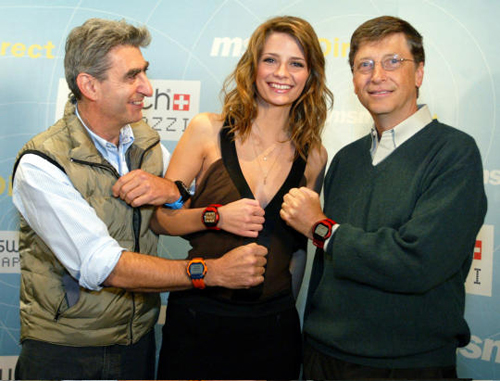 Microsoft's Bill Gates shows off it's SPOT Watches along with actress Micsha Barton.