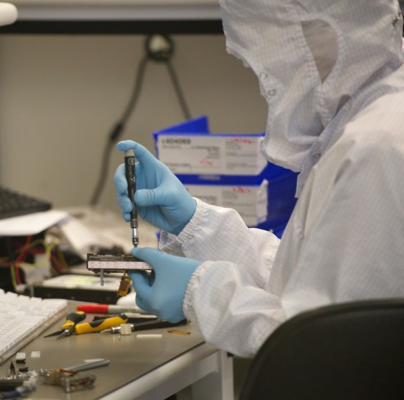 A DriveSavers technician replaces hard drive components